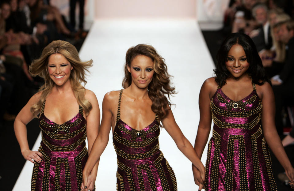 British music group Sugababes, from left to right, Heidi Range, Amelle Berrabah and Keisha Buchanan, take to the catwalk at the Fashion For Relief show, during London Fashion Week at The Natural History Museum in central London, Wednesday Sept. 17, 2008. Funds were raised by the show and a following auction for The White Ribbon Alliance charity to be used directly to promote and increase awareness of the need to make pregnancy and childbirth safe for women and newborns in developing and developed countries. (AP Photo/Lefteris Pitarakis)