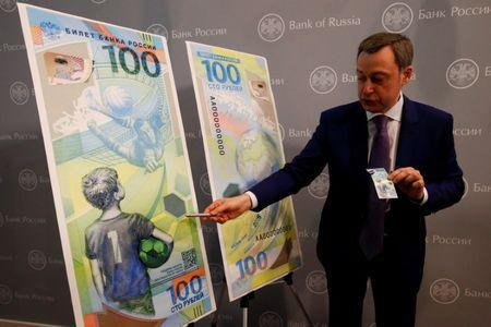 FILE PHOTO: General Director of Goznak state firm Arkady Trachuk attends a news conference unveiling the newly designed 100-rouble banknote dedicated to the 2018 FIFA World Cup, in Moscow, Russia May 22, 2018. REUTERS/Sergei Karpukhin/File Photo