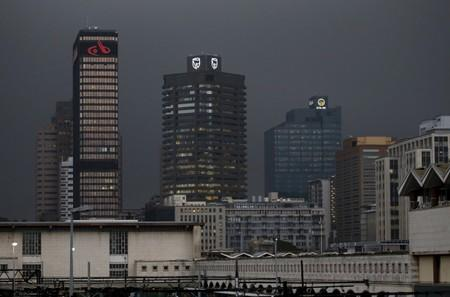 The logos of South Africa's three biggest banks, ABSA, Standard Bank and First National Bank, adorn buildings as winter storms hit Cape Town
