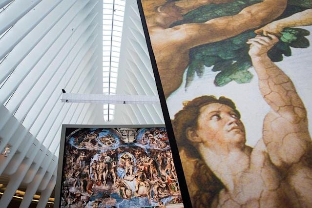 <p>Replicas of Michelangelo's Sistine Chapel frescoes are displayed inside of the Oculus at the World Trade Center Transportation Hub in New York City. The exhibit contains 34 nearly life-size copies of the frescoes. (Photo by Drew Angerer/Getty Images) </p>