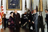<p>After taking the oath of office as Chief of Protocol for the State Department, Shirley Temple poses for photos with President Ford.</p>