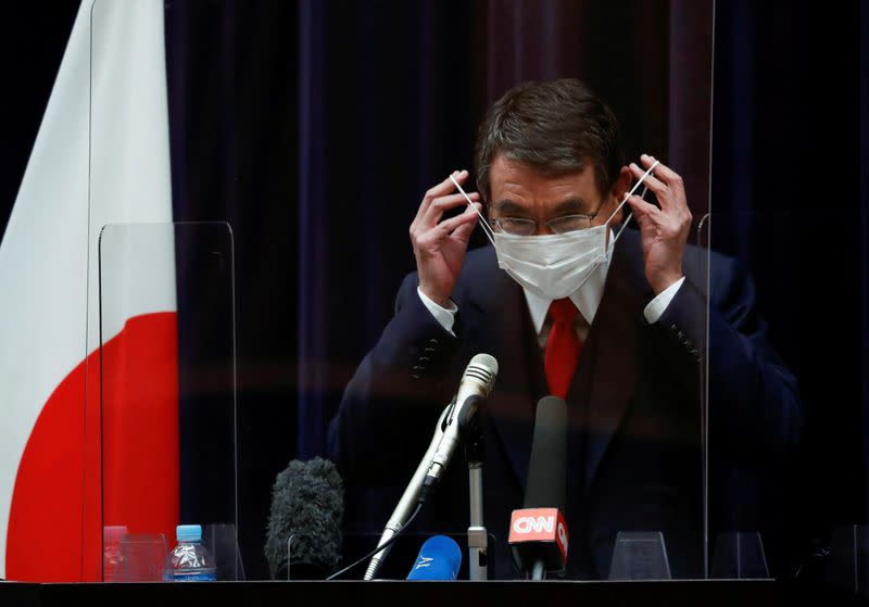 FILE PHOTO: Japanese minister in charge of vaccine roll-out holds news conference on preparations, in Tokyo
