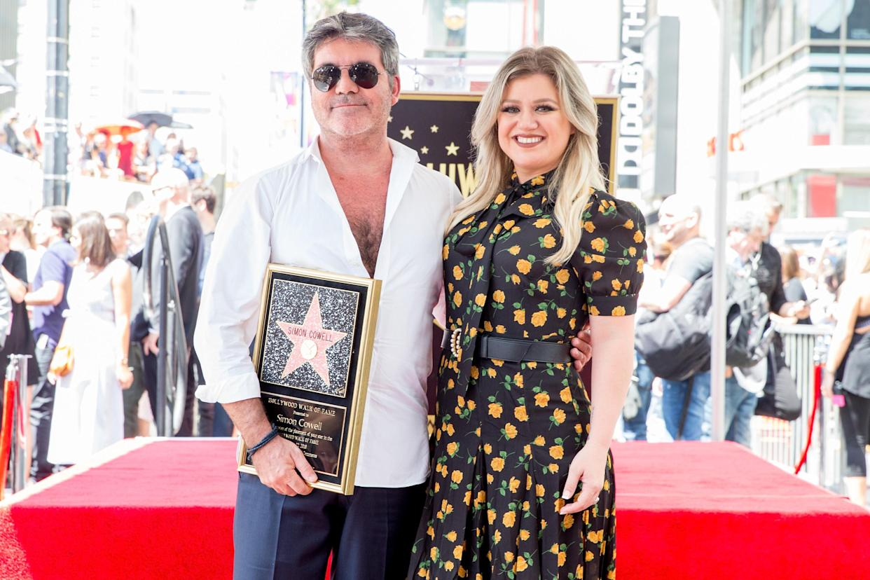 Kelly Clarkson helped honor Simon Cowell at his Hollywood Walk of Fame ceremony on Aug. 22, 2018. (Photo: Rich Fury/Getty Images)