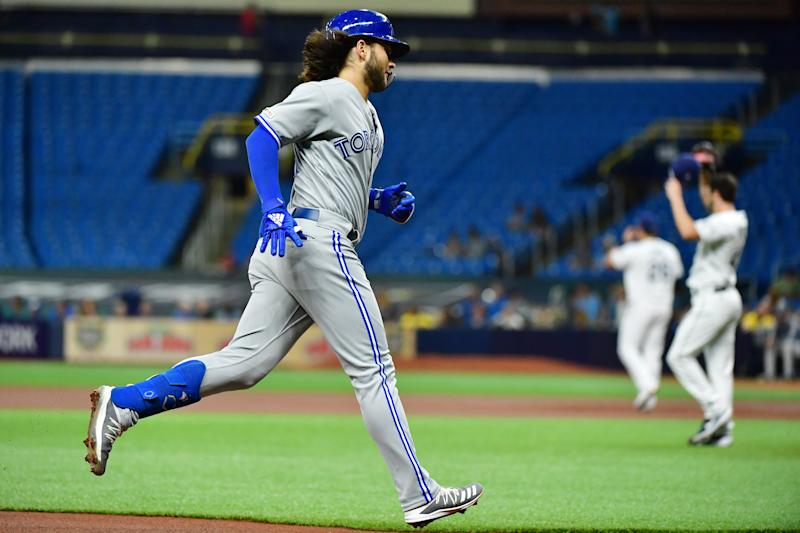 ST. PETERSBURG, FLORIDA - SEPTEMBER 05: Bo Bichette #11 of the Toronto Blue Jays runs the bases after hitting a home run off of Austin Pruitt #45 of the Tampa Bay Rays in the first inning of a baseball game at Tropicana Field on September 05, 2019 in St. Petersburg, Florida. (Photo by Julio Aguilar/Getty Images)