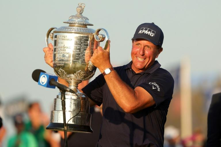 Phil Mickelson hoists the Wanamaker Trophy after winning the 2021 PGA Championship to become, at 50, golf's oldest major champion