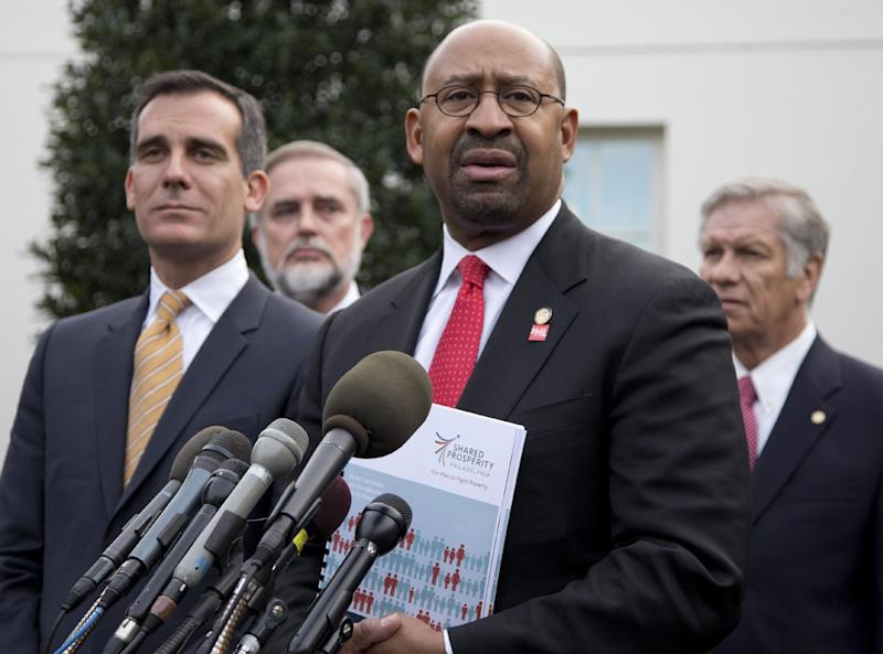 Philadelphia Mayor Michael Nutter speaks to media outside the White House in Washington, Thursday, Jan. 9, 2014, after an event with President Barack Obama about the Promise Zones Initiative. At left is Los Angeles Mayor Eric Garcetti. The Promise Zone Initiative is part of a plan to create a better bargain for the middle-class by partnering with local communities and businesses to create jobs, increase economic security, expand educational opportunities, increase access to quality, affordable housing and improve public safety. (AP Photo/Carolyn Kaster)