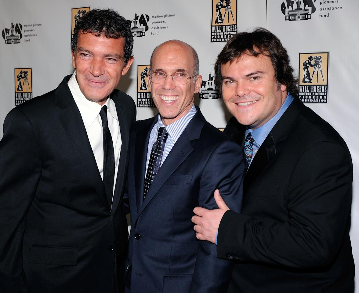 LAS VEGAS, NV - APRIL 25:  (L-R) Actor Antonio Banderas, DreamWorks Animation CEO Jeffrey Katzenberg and actor Jack Black arrive at a Will Rogers Motion Picture Pioneers Foundation dinner honoring Katzenberg with the 2012 Pioneer of the Year Award at Caesars Palace during CinemaCon, the official convention of the National Association of Theatre Owners, on April 25, 2012 in Las Vegas, Nevada.  (Photo by Ethan Miller/Getty Images)