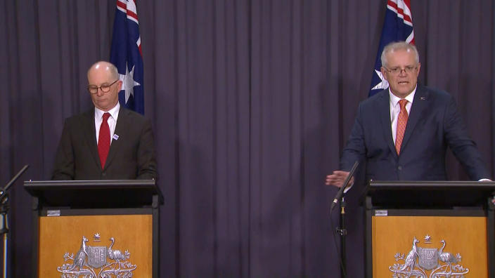 In this image made from video, Australian Prime Minister Scott Morrison, right, with Australian Chief Medical Officer Paul Kelly, speaks during a news conference in Canberra, Australia, Thursday, April 8, 2021. Australia on Thursday become the latest country to restrict use of the AstraZeneca vaccine by recommending that it not be given to people under age 50. (SBS via AP)