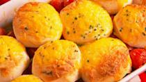 """<p>Fluffy biscuits and oven-roasted tomatoes make summer's best cobbler.<br></p><p>Get the recipe from <a href=""""https://www.countryliving.com/cooking/recipe-ideas/recipes/a48782/tomato-cobbler-recipe/"""" rel=""""nofollow noopener"""" target=""""_blank"""" data-ylk=""""slk:Delish"""" class=""""link rapid-noclick-resp"""">Delish</a>.</p>"""