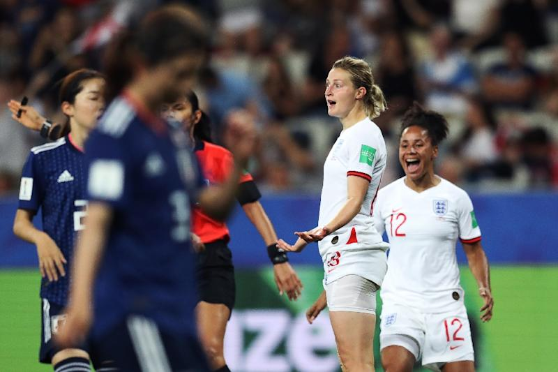 England forward Ellen White celebrates with number 12 Demi Stokes after scoring her second goal in the 2-0 win over Japan (AFP Photo/Valery HACHE)