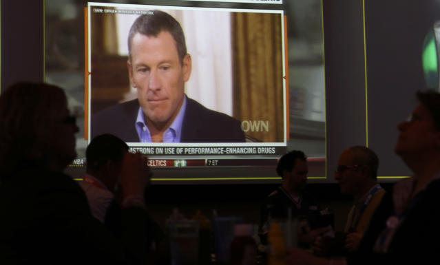 A video screen at a hotel restaurant in Grapevine, Texas, Friday, Jan. 18, 2013, shows a replay telecast of a segment of Lance Armstrong being interviewed by Oprah Winfrey, Reversing more than a decade of denials, Armstrong confessed to using performance-enhancing drugs to win the Tour de France cycling during the interview that aired night before. The second part of the interview will air tonight. (AP Photo/LM Otero)