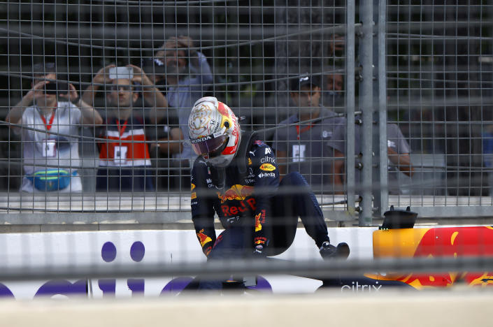 Red Bull driver Max Verstappen of the Netherlands gets out of his car after crashing out during the Formula One Grand Prix at the Baku Formula One city circuit in Baku, Azerbaijan, Sunday, June 6, 2021. (Maxim Shemetov, Pool via AP)