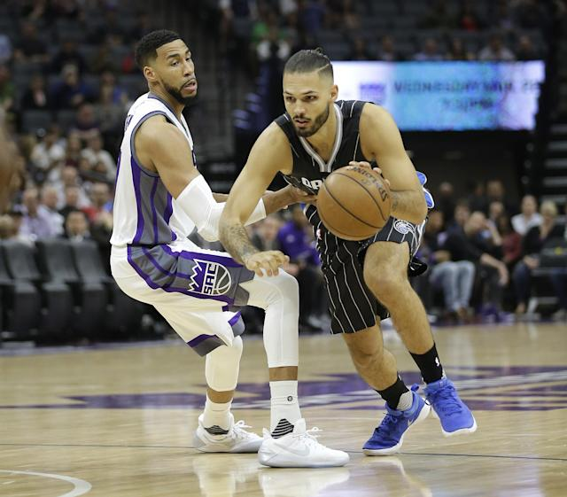 Magic guard Evan Fournier, right, drives against the Kings' Garrett Temple in a March game. (AP)