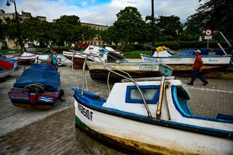 Cuban fishermen dragged their boats to safety as tropical storm Elsa approached