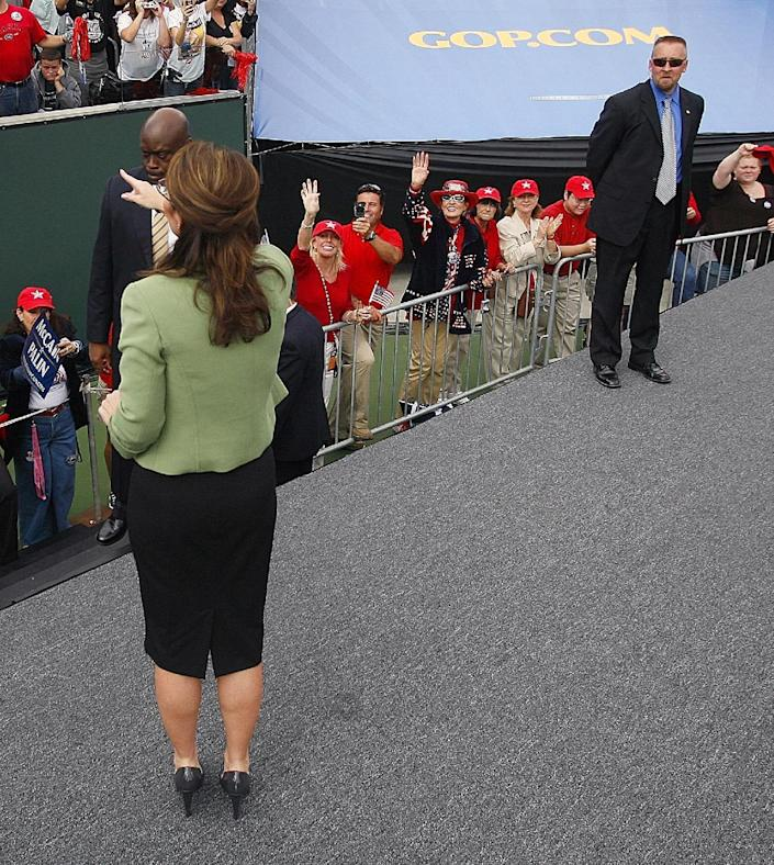 In this photo taken Oct. 4, 2008, David Chaney, right, who identified himself on his Facebook account as a member of Republican Vice Presidential candidate Sarah Palin's Secret Service detail, watches Palin during a rally in Carson, Calif. Chaney's lawyer, Lawrence Berger of New York, said he is representing Chaney in the fallout from the prostitution scandal inside the Secret Service. (AP Photo/Chris Carlson)