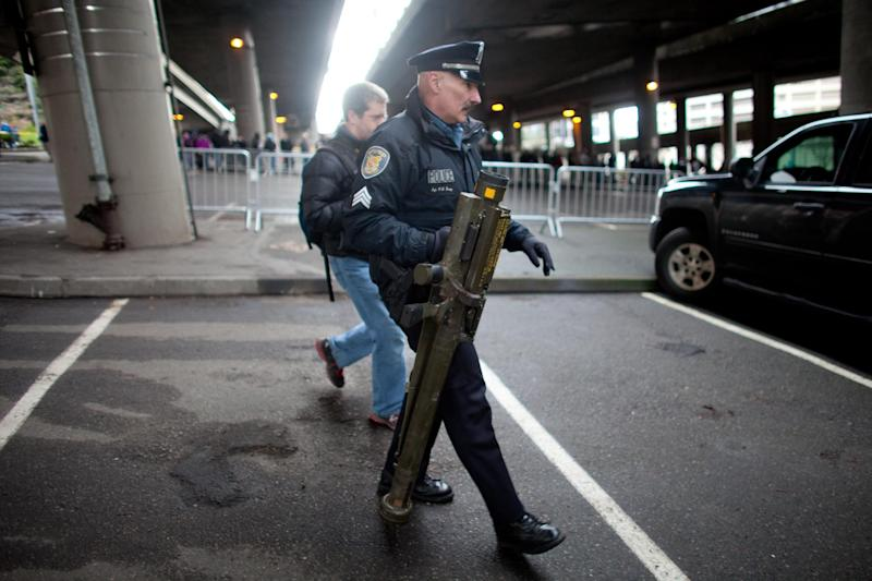 Seattle Police Department Sgt. Paul Gracy holds an inert surface to air missile launcher brought to a gun buy back program run by the Seattle Police Department on Saturday, Jan. 26, 2013. The city has collected donations totaling nearly $120,000 to pay for a series of gun buyback events. Participants have been asked to unload and secure their weapons in the trunk of their vehicle or in a locked container. (AP Photo/seattlepi.com, Joshua Trujillo)