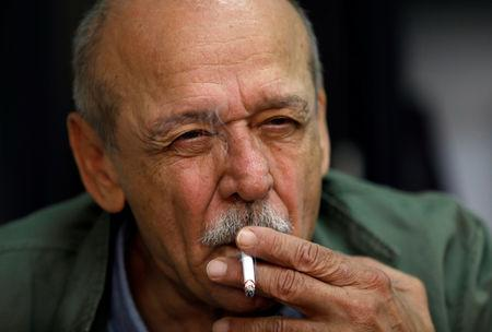 Yasser Abed Rabbo, former official of Palestinian Liberation Organization (PLO), smokes a cigarette during an interview with Reuters, in Ramallah, in the occupied West Bank September 9, 2018.  REUTERS/Mohamad Torokman