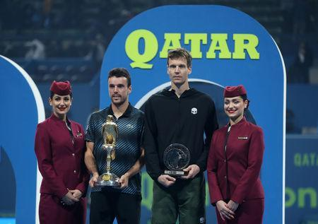 Tennis - ATP - Qatar Open - Khalifa International Tennis and Squash Complex, Doha, Qatar - January 5, 2019 Spain's Roberto Bautista Agut and Czech Republic's Tomas Berdych celebrate with their trophies after Roberto Bautista Agut wins the final REUTERS/Ibraheem Al Omari