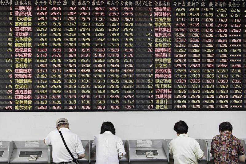China Brokers Sink on Report Banks May Get Securities' Licenses