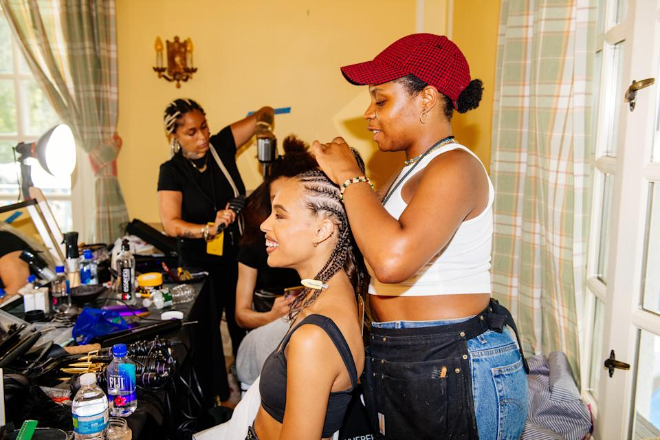 Cornrows in progress backstage at Pyer Moss.