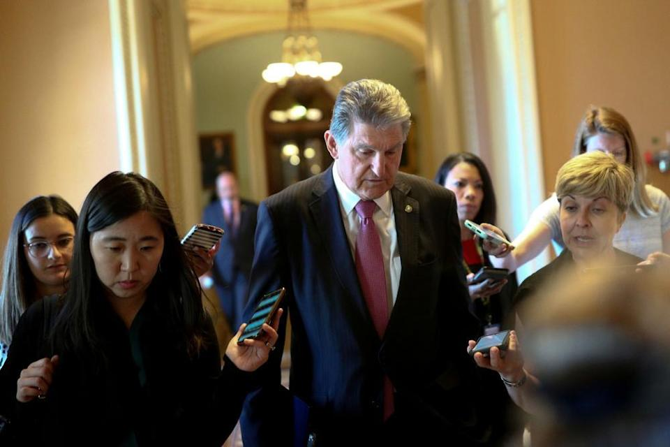 Senator Joe Manchin, Democrat of West Virginia, speaks to reporters before attending a meeting on infrastructure on Capitol Hill.
