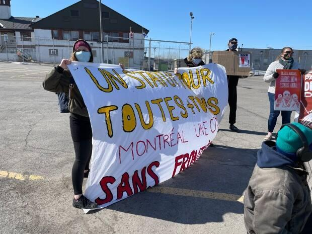 People gathered in front of the Immigration Holding Centre in Laval on Saturday to call for change. (Alex Leduc/CBC - image credit)