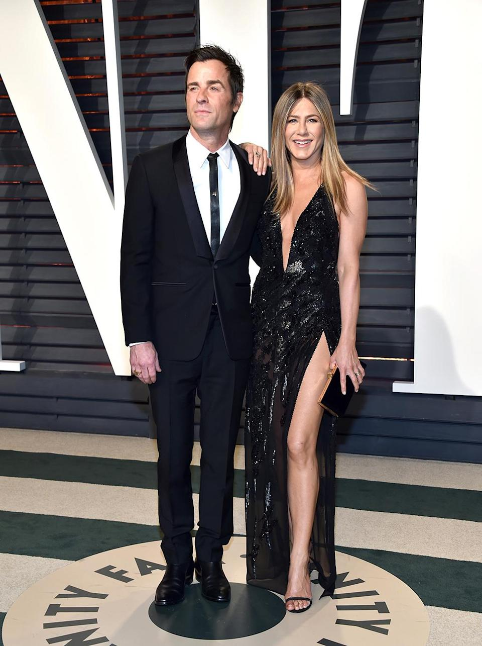 <p>Justin Theroux and Jennifer Aniston were ready to party! The couple wore black — of course — but fancier ensembles than usual as they arrived for the <i>Vanity Fair</i> fete. Just as predictably, the high leg slit on Aniston's dress quickly had people comparing her to Angelina Jolie. (Photo by Pascal Le Segretain/Getty Images) </p>