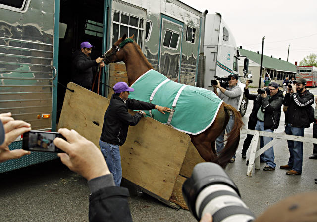 California Chrome arrives at Churchill Downs for the Kentucky Derby in Louisville, Ky., Monday, April 28, 2014. California Chrome has won his last four races by a combined 24 ¼ lengths. (AP Photo/Garry Jones)