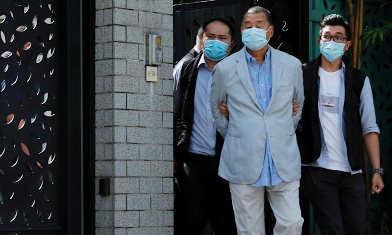 Jimmy Lai is detained by the national security unit in Hong Kong on Monday.