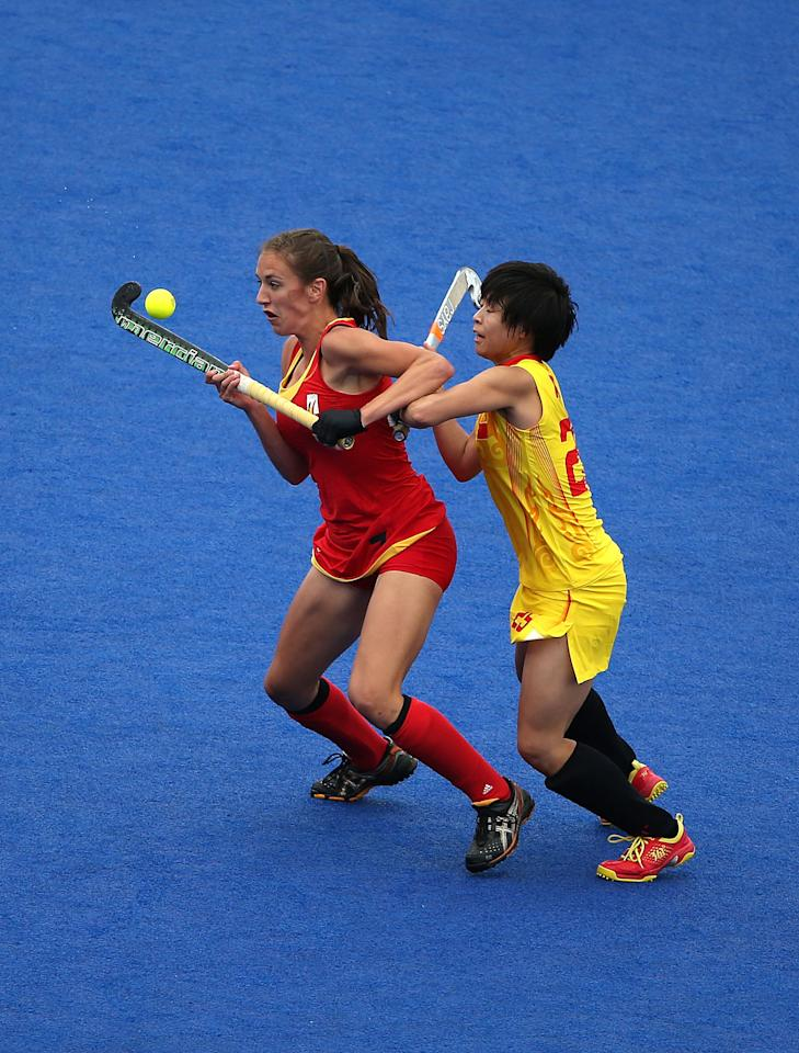 LONDON, ENGLAND - JULY 31:  Judith Vandermeiren (L) of Belgium and Xiaoxu Xu of China eye the ball during the Women's Hockey Match between Belgium and China on day 4 of the London 2012 Olympic Games at Riverbank Arena on July 31, 2012 in London, England.  (Photo by Daniel Berehulak/Getty Images)