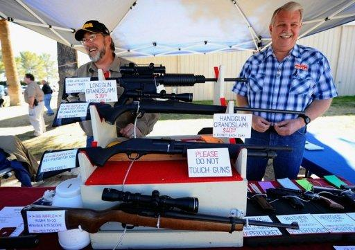 "Vendors display hunting rifles for sale at a gun show in Tucson, Arizona in January 2011. The US Bureau of Alcohol, Tobacco, Firearms and Explosives said earlier this week that it would ask US gun dealers in the border states of Texas, Arizona, California and New Mexico to report ""multiple"" sales of semi-automatic rifles"
