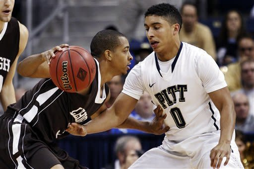 Lehigh's C.J. McCollum, left, drives against Pittsburgh's James Robinson (0) in the first half of their NCAA college basketball game in the NIT Season Tip-Off tournament, Tuesday, Nov. 13, 2012, in Pittsburgh. (AP Photo/Keith Srakocic)