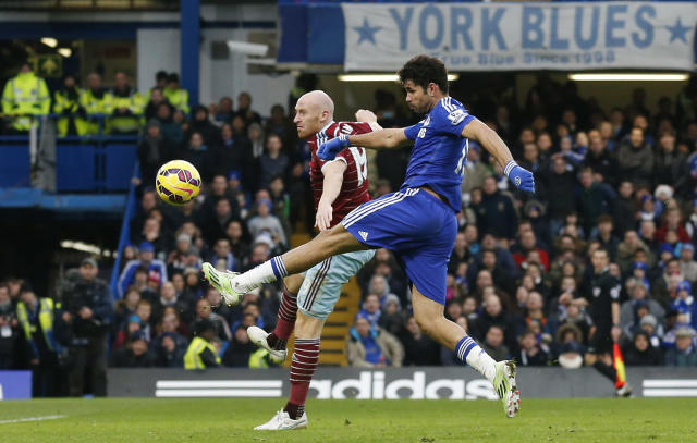 Diego Costa (foreground) outplays James Collins during Chelsea's match against West Ham at Stamford Bridge on December 26, 2014 (AFP Photo/Justin Tallis)