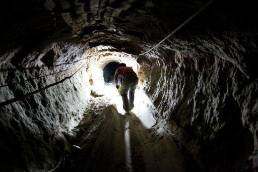 """A Palestinian man works at a tunnel used for smuggling goods into the Gaza Strip, which links Egypt to the southern Gaza town of Rafah in 2011. """"If this closure continues it will be a disaster,"""" says Abu Taha, who runs one of hundreds of cross-border smuggling tunnels that were closed after a deadly attack in the Sinai"""