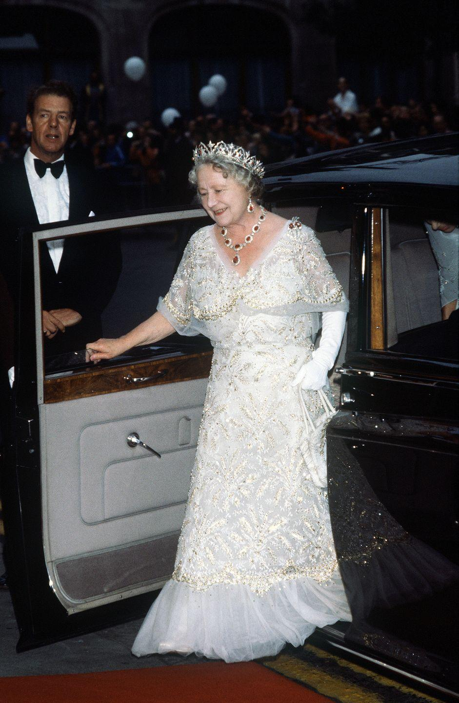 <p>Queen Elizabeth, the Queen Mother, wore a white chiffon evening gown to her 80th birthday celebration in 1980. She paired the gown with a stunning tiara and necklace set. </p>