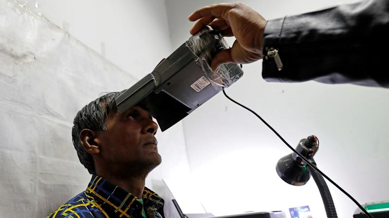A man goes through the process of eye scanning for the Unique Identification (UID) database system, also known as Aadhaar, at a registration centre in New Delhi, India, January 17, 2018. Picture taken January 17, 2018. REUTERS/Saumya Khandelwal - RC1F67907F80
