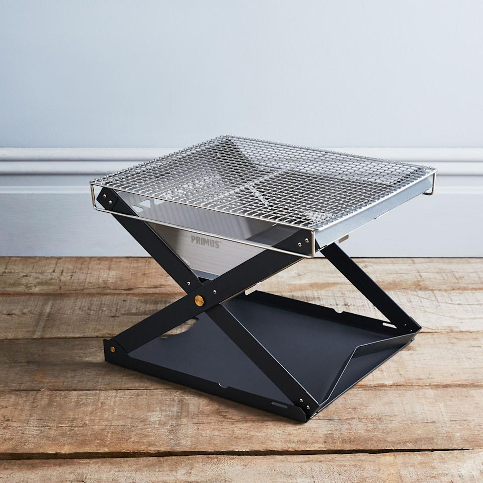 """This steel fire pit folds up flat, making it perfect for campers and travelers. But even if you aren't an avid camper, it's a solid choice for an everyday, backyard fire pit. $150, Food52. <a href=""""https://food52.com/shop/products/4813-kamoto-folding-fire-pit-open-fire-pan"""">Get it now!</a>"""