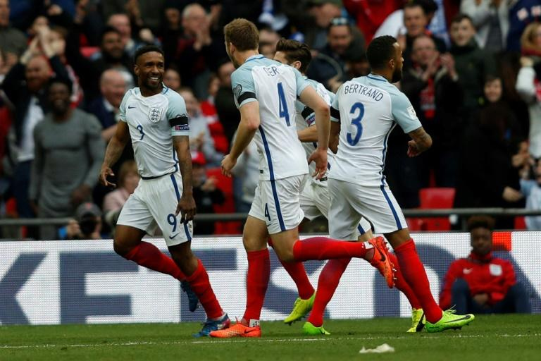 England's striker Jermain Defoe (L) celebrates with teammates after scoring against Lithuania at Wembley Stadium in London on March 26, 2017