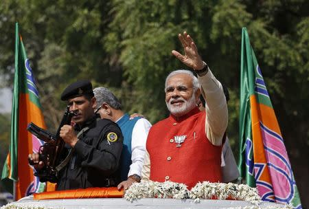 Hindu nationalist Narendra Modi, prime ministerial candidate for Bharatiya Janata Party (BJP), waves to his supporters as he arrives to file nomination papers for the general elections in Vadodara, in Gujarat April 9, 2014. REUTERS/Amit Dave