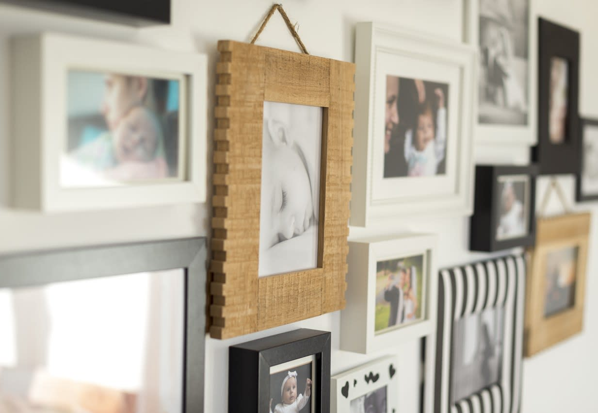 """Sure, those posters and photos taped to your walls may have looked fine in college, but adult you deserves some more mature wall décor. If you don't want to ditch the posters and pictures entirely, decorator <a href=""""https://www.linkedin.com/in/allyson-kozich-15796915/"""" target=""""_blank""""><strong>Allyson Kozich</strong></a>—owner of <a href=""""https://www.facebook.com/pages/Interiors-by-Allyson/1476017229288834"""" target=""""_blank"""">Interiors by Allyson</a> in Fort Lauderdale, Florida—recommends buying quality frames for them to at least make them look more put together."""