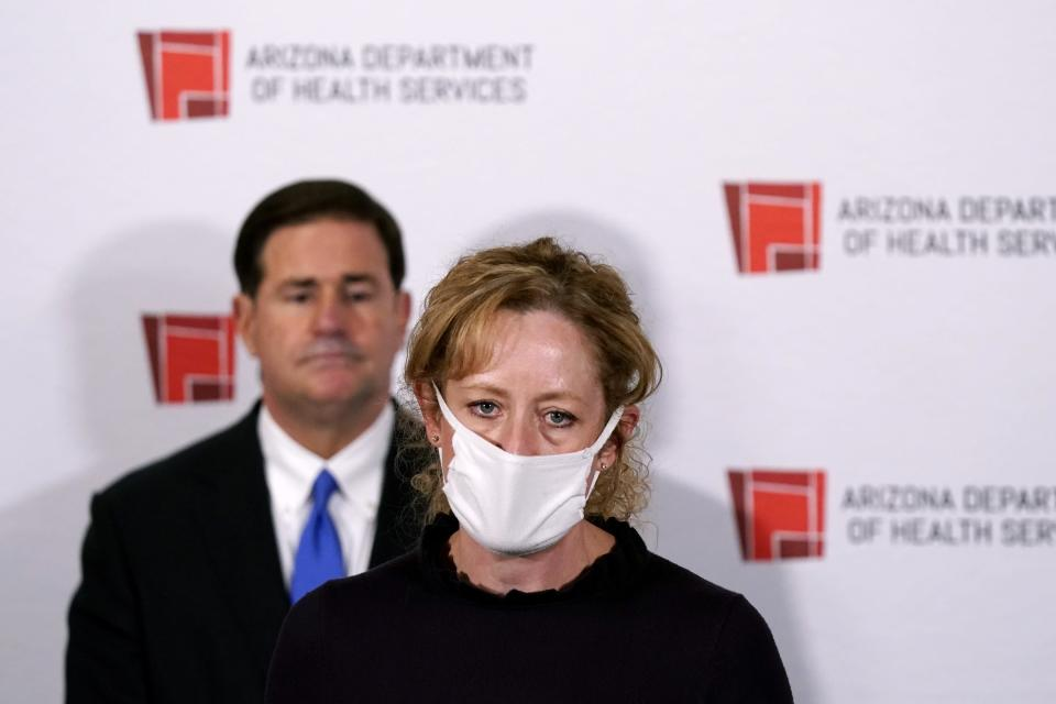 FILE - In this Dec. 2, 2020, file photo, Arizona Department of Health Services Director Dr. Cara Christ speaks as Republican Arizona Gov. Doug Ducey listens during a news conference in Phoenix. Arizona's top health official, who has been the face of the state response to the pandemic, is leaving the role next month. Gov. Ducey announced Wednesday, July 28, 2021, that Dr. Christ, director of the Arizona Department of Health Services, has accepted a role as chief medical officer for Blue Cross Blue Shield of Arizona. (AP Photo/Ross D. Franklin, Pool)