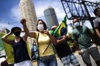 A group of demonstrators formed by former supporters of Brazil's President Jair Bolsonaro protest against the government's response in combating COVID-19 and demanding Bolsonaro's impeachment, in Rio de Janeiro, Brazil, Sunday, Jan. 24, 2021. (AP Photo/Bruna Prado)
