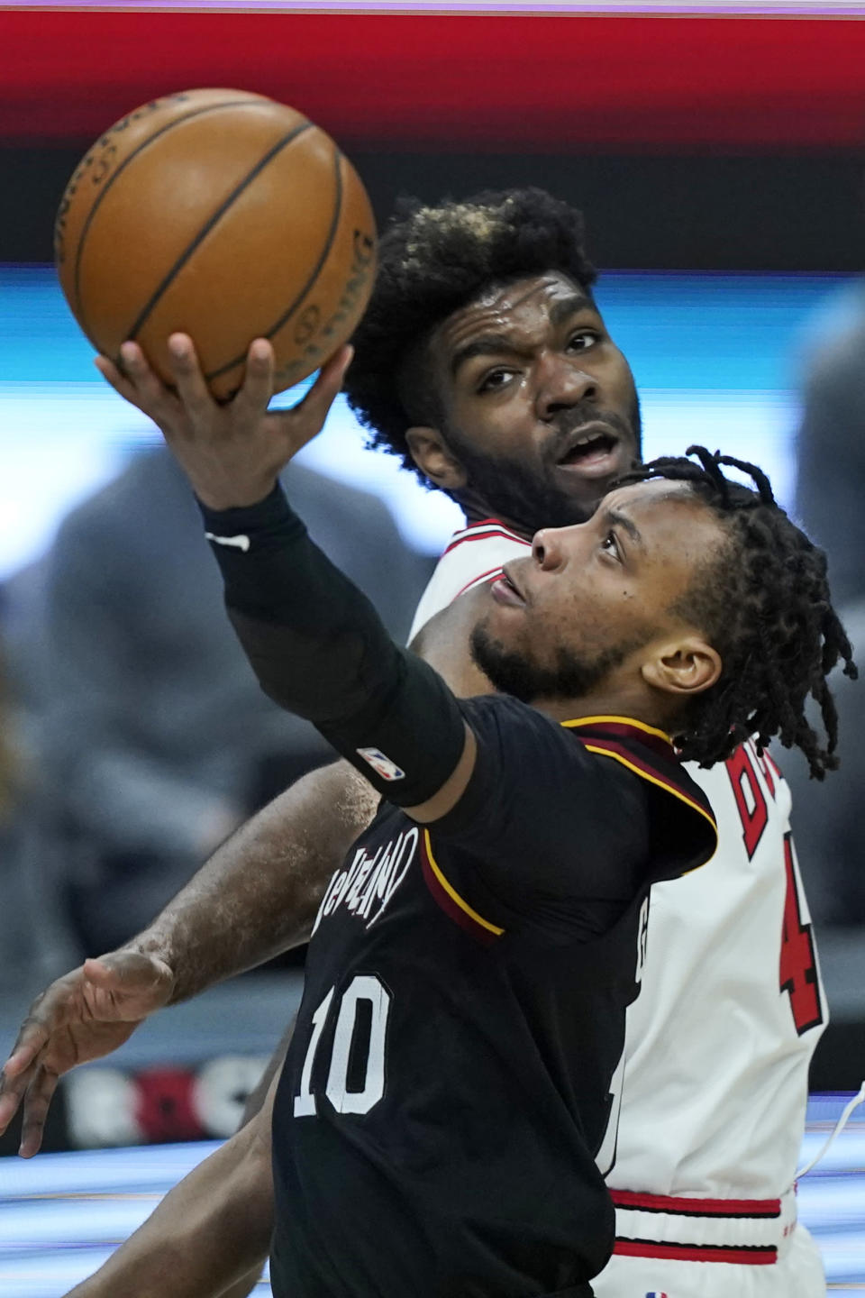 Cleveland Cavaliers' Darius Garland drives to the basket against Chicago Bulls' Patrick Williams during the second half of an NBA basketball game Wednesday, April 21, 2021, in Cleveland. (AP Photo/Tony Dejak)