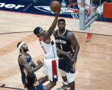 Washington Wizards guard Bradley Beal (3) shoots past New Orleans Pelicans forward Brandon Ingram (14) and forward Zion Williamson (1) in the second quarter of an NBA basketball game in New Orleans, Wednesday, Jan. 27, 2021. (AP Photo/Derick Hingle)