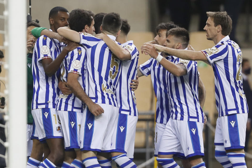 Real Sociedad players celebrate scoring their side's first goal during the final of the 2020 Copa del Rey, or King's Cup, soccer match between Athletic Bilbao and Real Sociedad at Estadio de La Cartuja in Sevilla, Spain, Saturday April 3, 2021. The game is the rescheduled final of the 2019-2020 competition which was originally postponed due to the coronavirus pandemic. (AP Photo/Angel Fernandez)