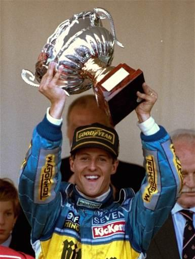 Michael Schumacher of Germany raises the victory cup after winning the Monaco Grand Prix Sunday May 28, 1995. (AP Photo/Lionel Cironneau)