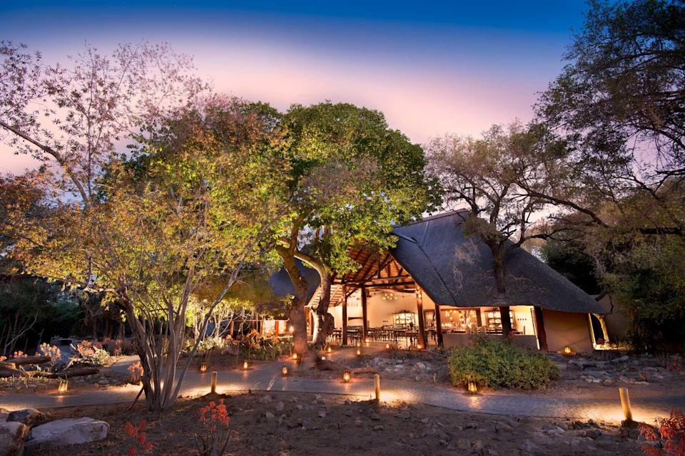 Exterior of the andBeyond Ngala Safari Lodge at night, voted one of the best hotels in the world