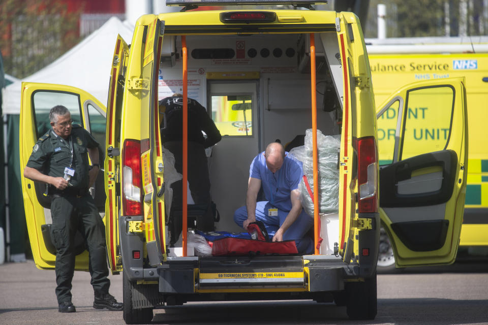 NHS workers prepare ambulances outside the NHS Nightingale Hospital at the Excel Centre in London as the UK continues in lockdown to help curb the spread of the coronavirus.