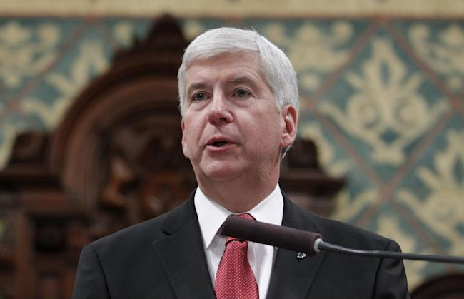 Michigan Gov. Rick Snyder delivers his State of the State address to a joint session of the House and Senate, at the state Capitol in Lansing, Mich. Snyder has released some, but not all, of his government emails related to Flint's water emergency. (Al Goldis/AP Photo)