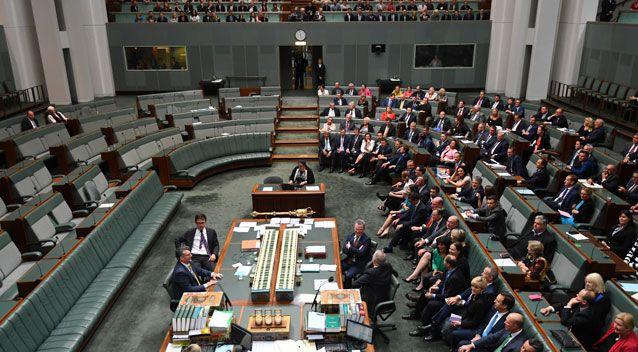 The four MPs who voted against the bill were seated alone in the House of Representatives. Photo: AAP